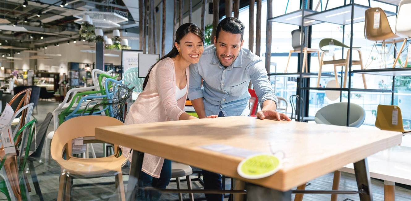 Young couple purchasing a new table.